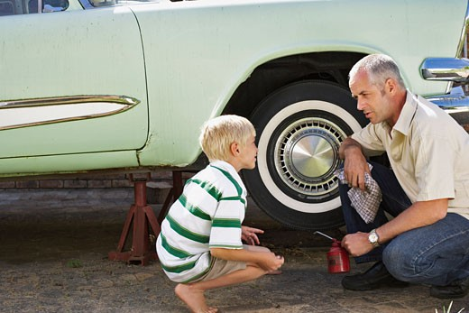 Stock Photo: 1828R-51616 Portrait of Family Fixing Car