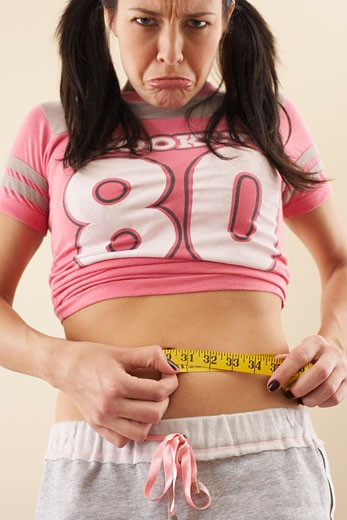 Stock Photo: 1828R-51685 Woman Measuring Her Waist