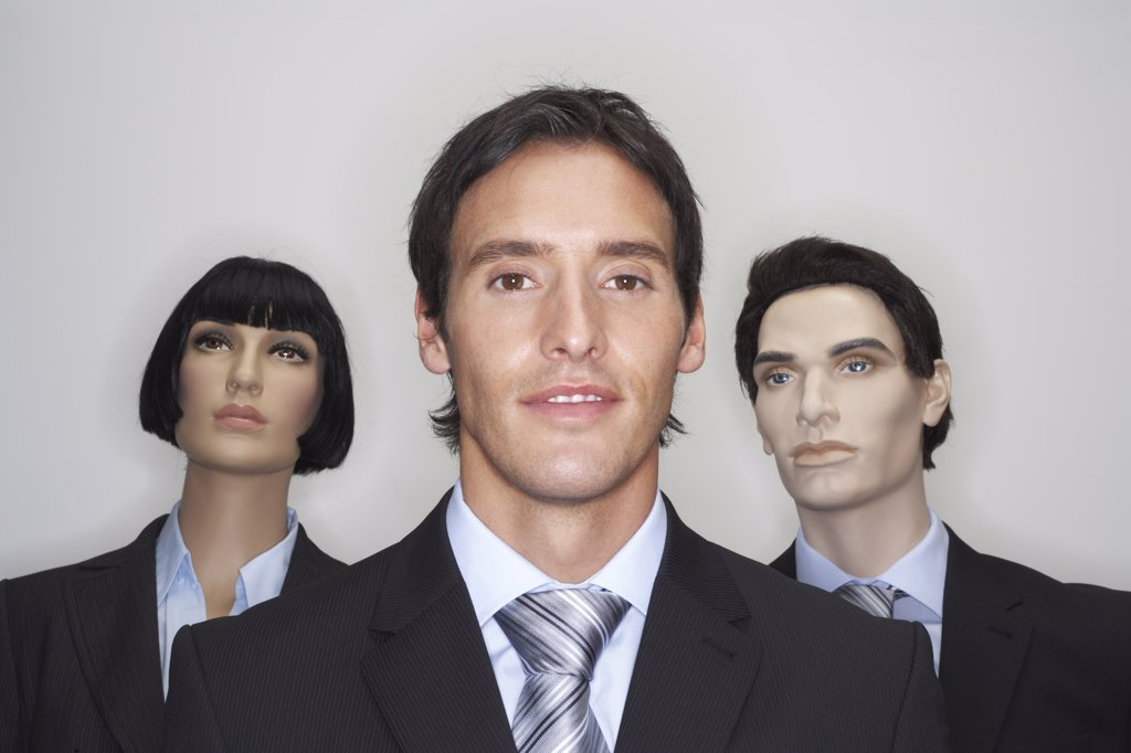 Businessman with Mannequins : Stock Photo