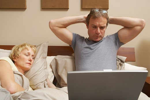 Stock Photo: 1828R-51985 Couple in Bed