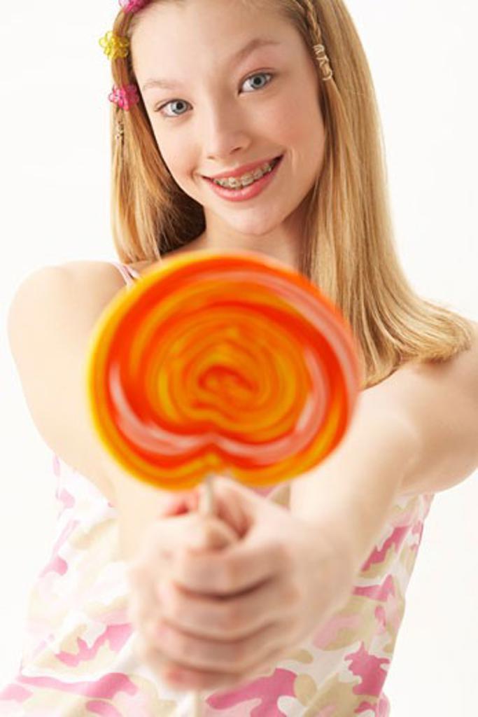 Girl Holding Lollipop    : Stock Photo