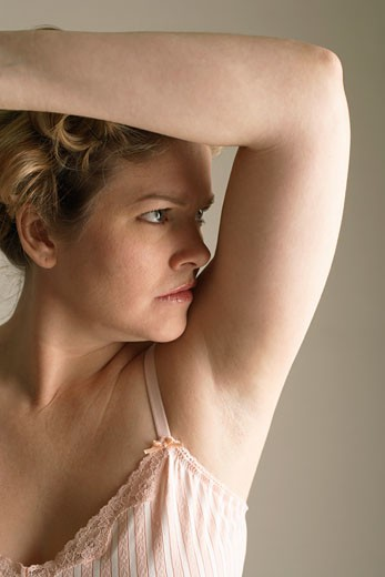 Woman Smelling Armpit    : Stock Photo