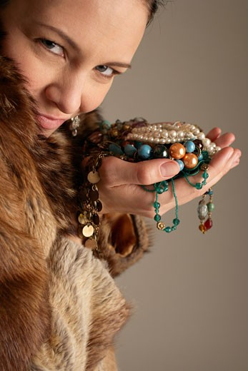 Stock Photo: 1828R-52239 Woman Holding Jewelry