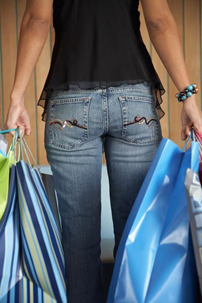 Stock Photo: 1828R-52269 Woman Carrying Shopping Bags