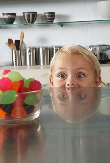 Stock Photo: 1828R-52522 Child Looking at Candy