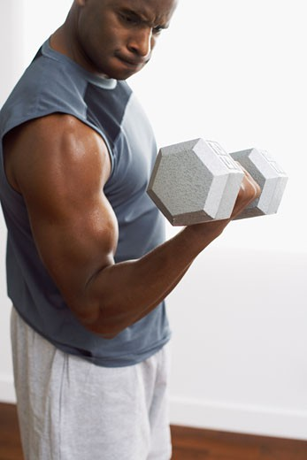 Stock Photo: 1828R-52824 Man Lifting Weights
