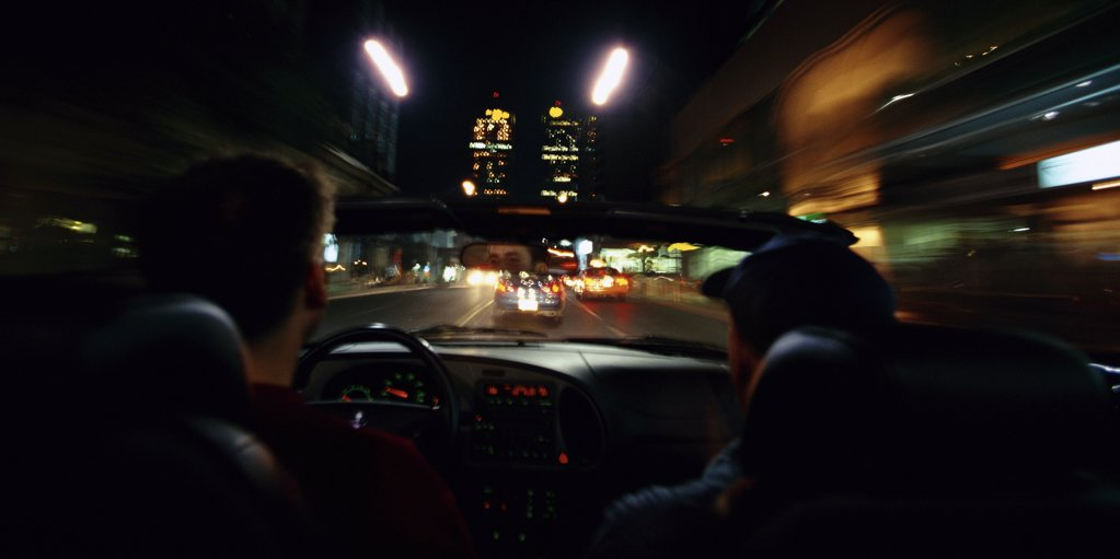 Stock Photo: 1828R-5297 Two Men Driving in Car at Night, Toronto, Ontario, Canada