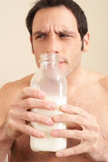 Stock Photo: 1828R-53118 Man Smelling Milk