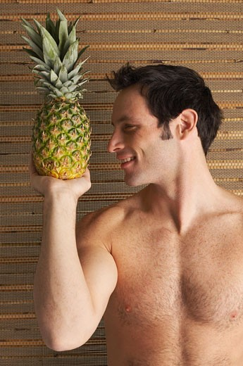 Stock Photo: 1828R-53156 Man Holding Pineapple