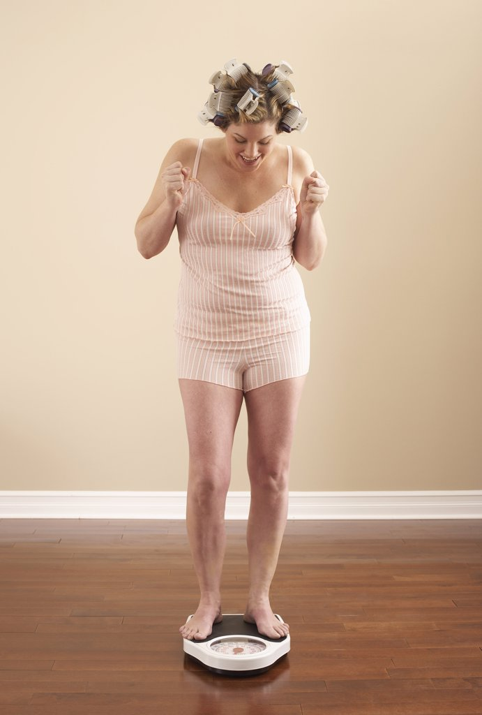 Stock Photo: 1828R-53185 Woman Weighing Self