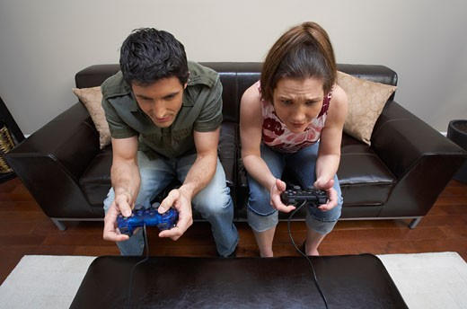 Stock Photo: 1828R-53297 Couple Playing Video Game