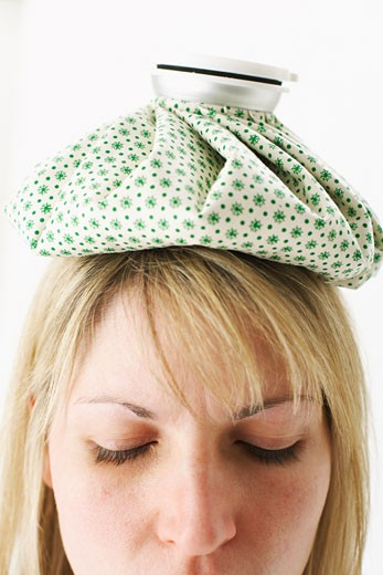 Stock Photo: 1828R-53506 Woman with Ice Pack on Head