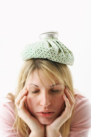 Woman with Ice Pack on Head    : Stock Photo