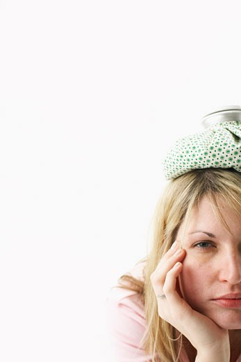 Stock Photo: 1828R-53508 Woman with Ice Pack on Head