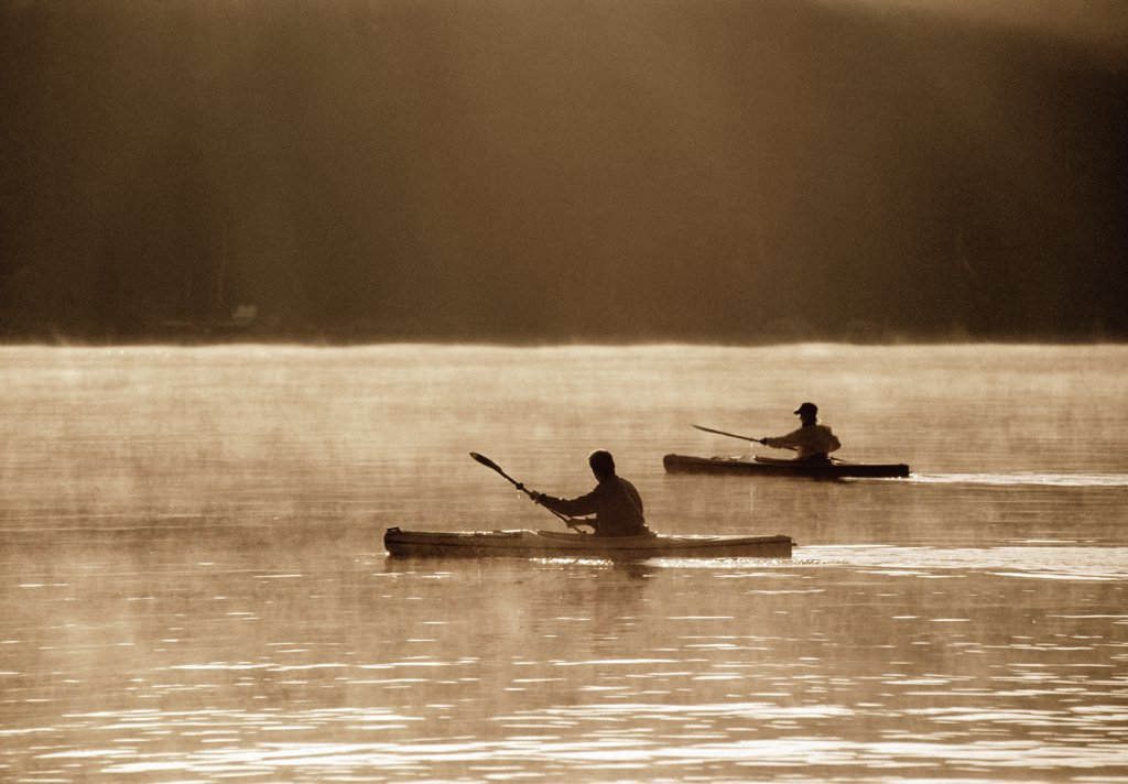 Silhouettes of People Kayaking    : Stock Photo