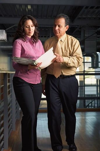 Stock Photo: 1828R-53766 Business People Looking at Document