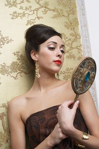Stock Photo: 1828R-53982 Woman Staring at Mirror