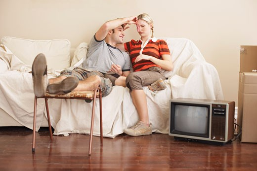 Stock Photo: 1828R-54384 Couple Sitting on Couch