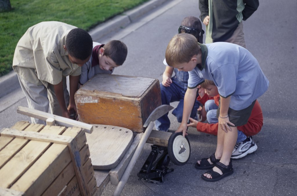Stock Photo: 1828R-5456 Group of Children Building Soapbox Car