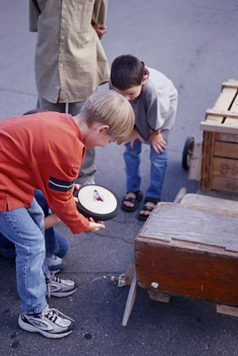 Stock Photo: 1828R-5457 Group of Children Building Soapbox Car