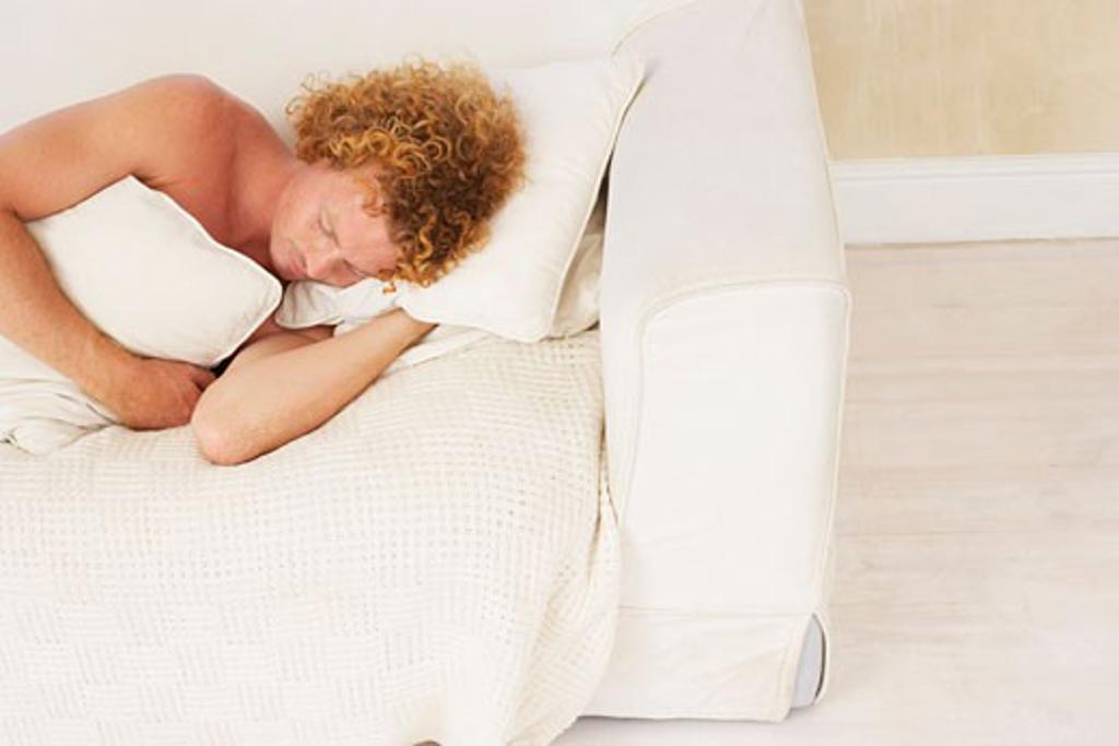 Stock Photo: 1828R-54939 Man Sleeping on Sofa