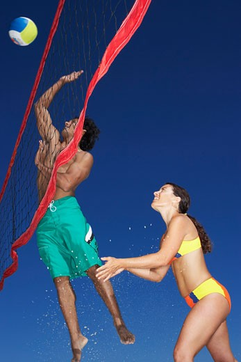 Stock Photo: 1828R-55052 People Playing Beach Volleyball