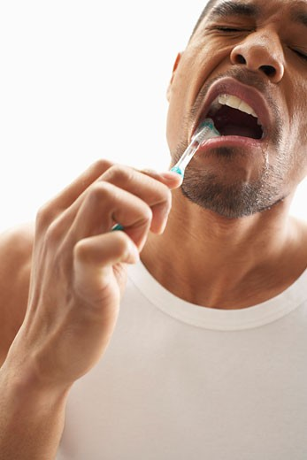 Stock Photo: 1828R-55420 Man Brushing Teeth