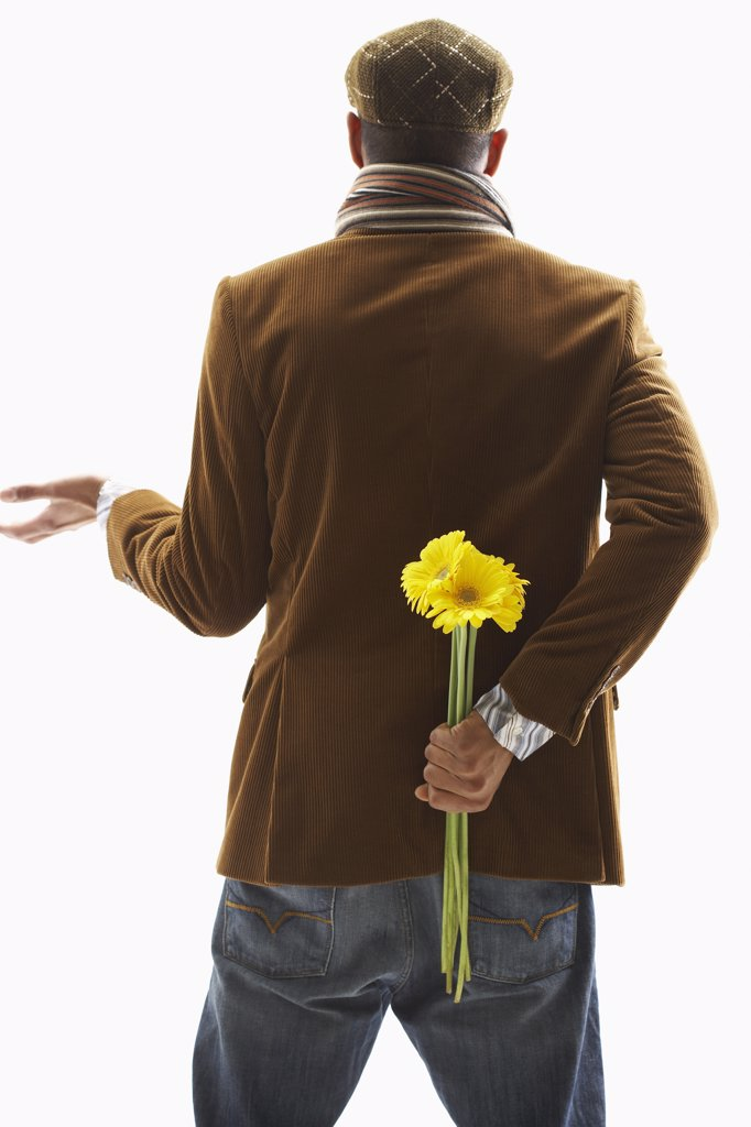 Stock Photo: 1828R-55442 Man Holding Flowers Behind Back