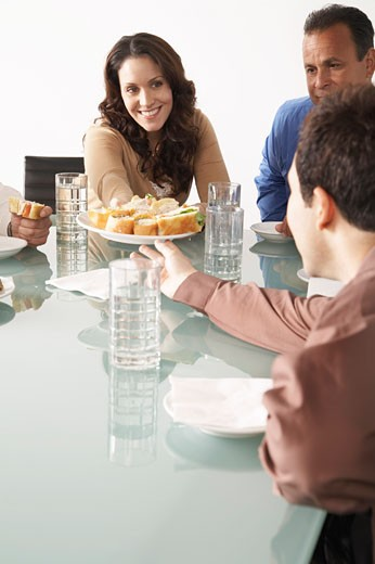 Business People with Snacks in Boardroom    : Stock Photo