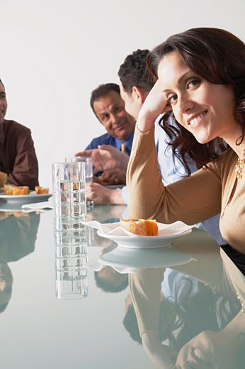 Stock Photo: 1828R-55664 Business People with Snacks in Boardroom