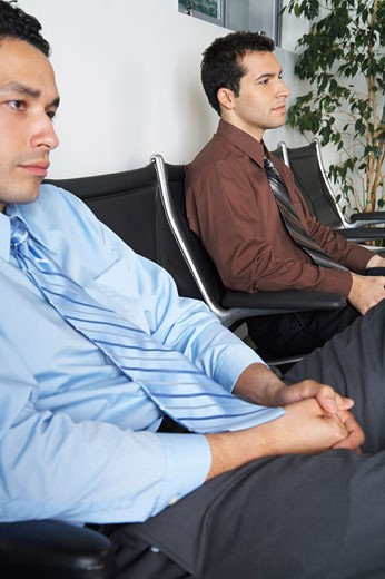 Stock Photo: 1828R-55677 Businessmen in Waiting Area