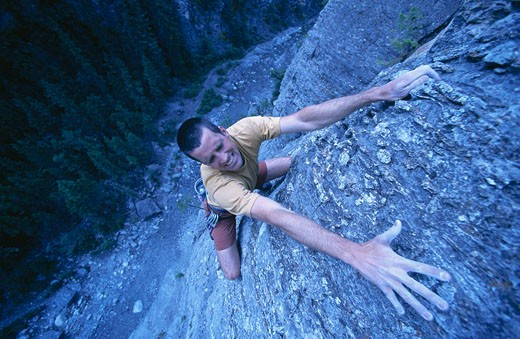 Stock Photo: 1828R-56580 Man Rock Climbing, Kananaskis Country, Alberta, Canada