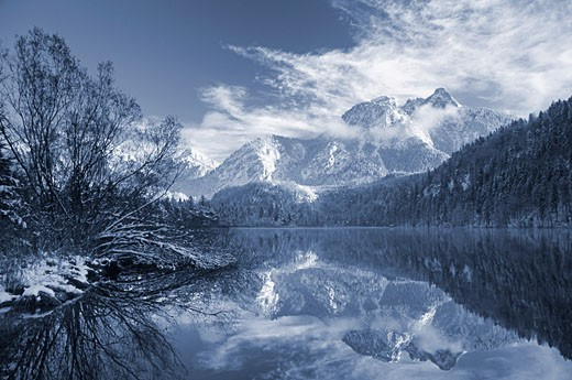 Stock Photo: 1828R-56711 Fuessen Reflected in Lake Schwansee, Bavaria, Germany