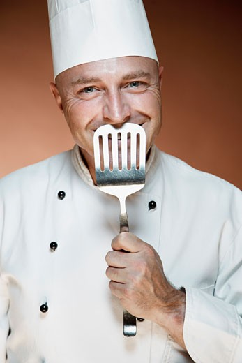 Stock Photo: 1828R-57475 Portrait of Chef Holding Spatula