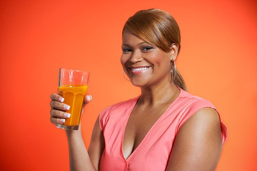 Stock Photo: 1828R-57519 Woman Drinking Carrot Juice