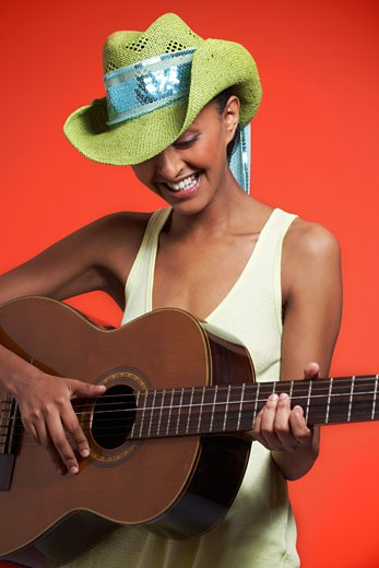 Stock Photo: 1828R-57532 Woman Playing Guitar