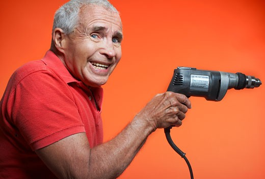 Stock Photo: 1828R-57575 Nervous Man Holding Power Drill