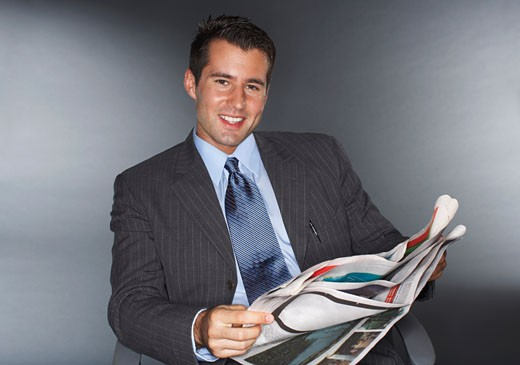 Stock Photo: 1828R-57632 Businessman Reading Newspaper