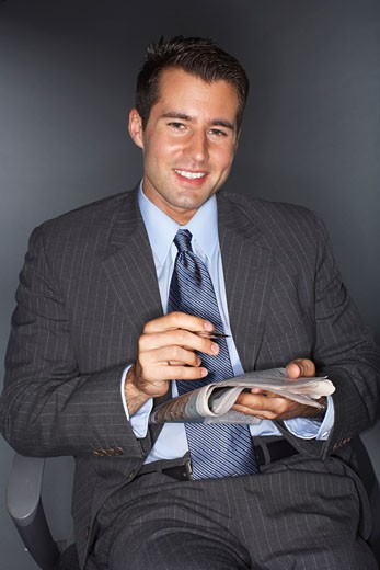 Stock Photo: 1828R-57633 Businessman Reading Newspaper