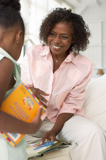 Stock Photo: 1828R-58060 Mother and Daughter With Books