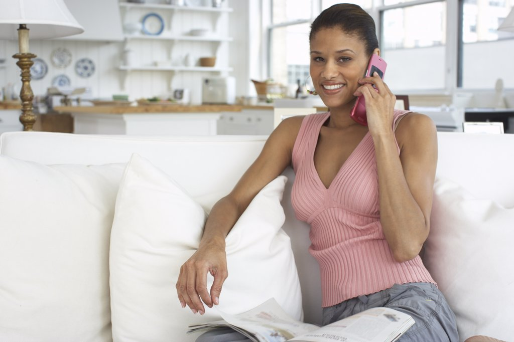 Stock Photo: 1828R-58139 Portrait of Woman at Home, Talking on Cellular Phone