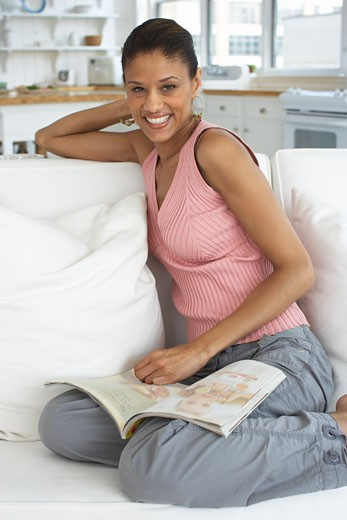 Woman Reading Magazine    : Stock Photo