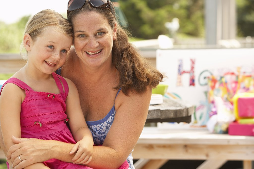 Stock Photo: 1828R-58180 Mother and Daughter at Birthday Party
