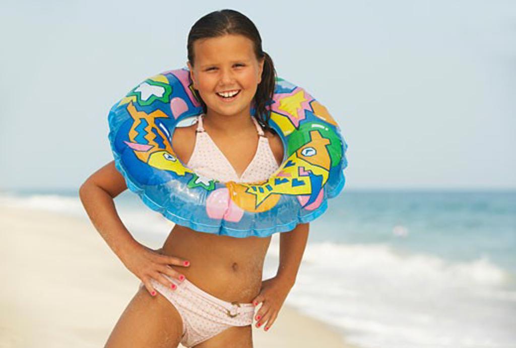 Stock Photo: 1828R-58229 Girl on Beach