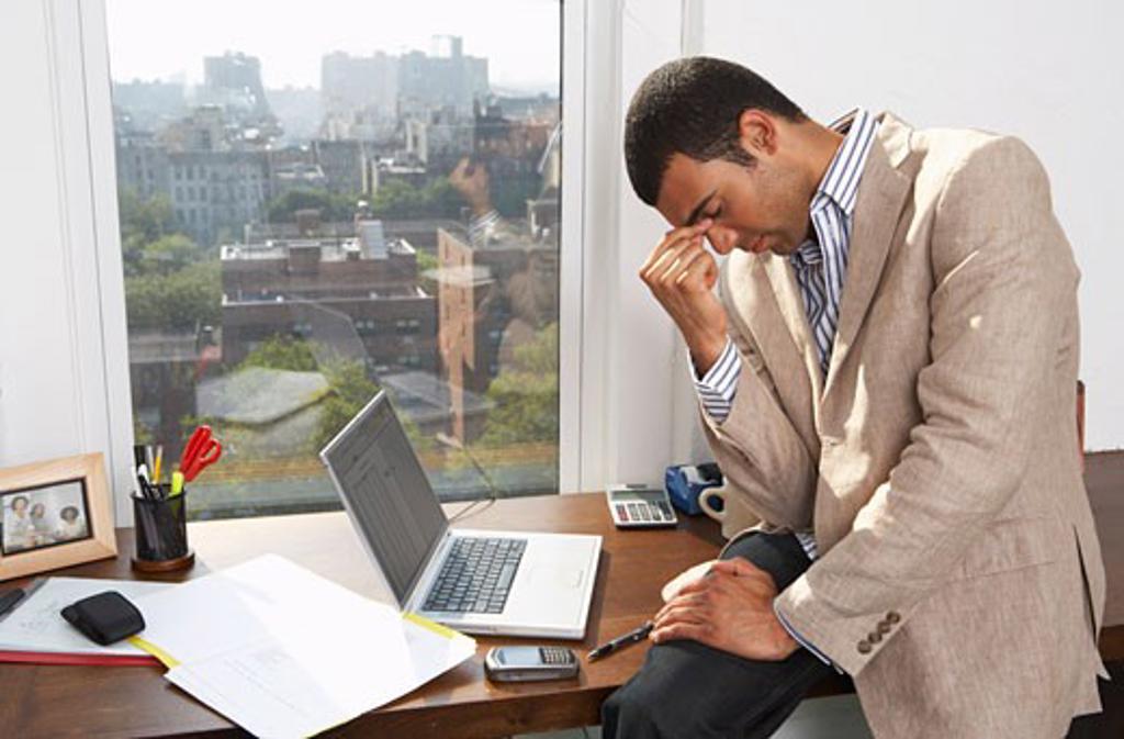 Stock Photo: 1828R-58428 Portrait of Stressed Businessman