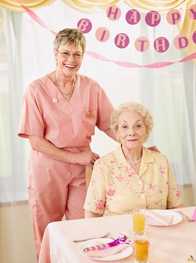 Stock Photo: 1828R-58709 Birthday Party in Retirement Home