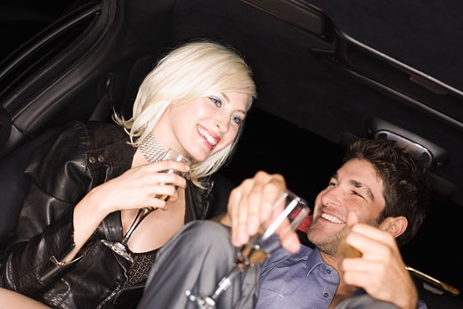 Stock Photo: 1828R-58876 Couple Drinking in Back of Limousine, Los Angeles, California, USA
