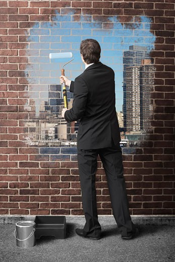 Stock Photo: 1828R-59329 Businessman Painting Cityscape on Brick Wall