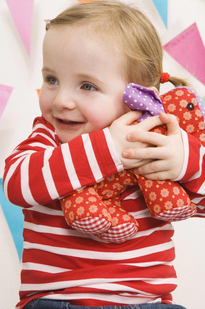 Stock Photo: 1828R-59471 Little Girl Hugging Her Stuffed Animal
