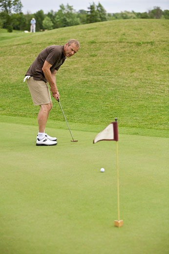 Stock Photo: 1828R-59902 Man Golfing, Burlington, Ontario, Canada